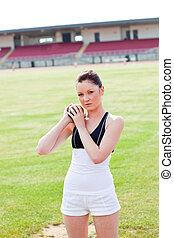 Concentrated female athlete holding