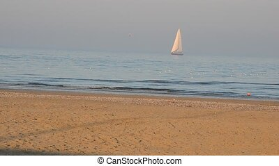 Sailboat on a winter sea - View of sailboat on a winter sea