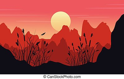 Silhouette of cliff with coarse grass landscape