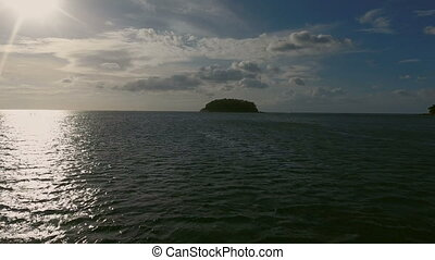 View above of small wild island in the sea. Professional...