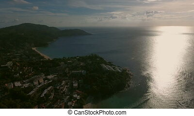 Aerial sunset view of beach and town