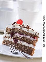 Cherry cake - Chocolate cake with cream and cherry close up...