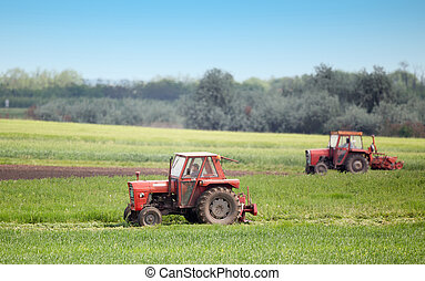 Tractors cutting lucerne - Tractors mowers cutting lucerne...
