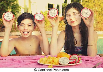 siblings teenager boy and girl with dracon cut fruit