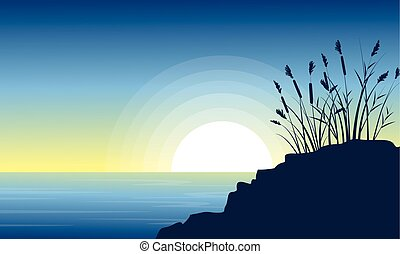 Beauty scenery lake with coarse grass silhouettes