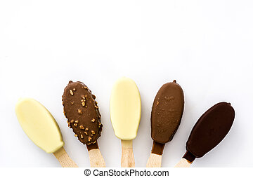 Chocolate ice cream popsicles isolated on white background.