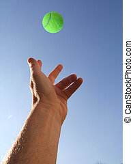 Tossing a tennis ball for serving