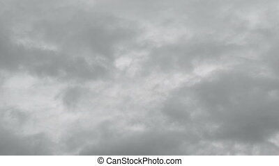 Fast moving gray clouds timelapse.