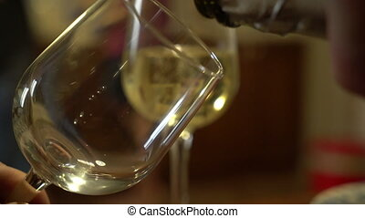 bottle with sparkling wine and goblets. - Two wineslasses on...