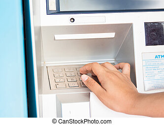 Press ATM EPP keyboard - Hand entering PIN/pass code on ATM.