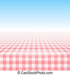 Empty picnic table, covered checkered tablecloth.