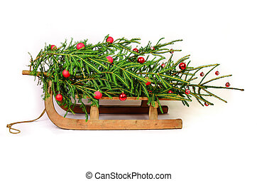 Sledge - Christmas tree on a old wooden sledge isolated on...