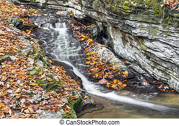Autumn Water Chute - Water streams down a limestone channel...