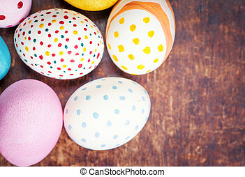 Easter eggs in nest on rustic wooden planks with copyspace....