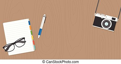 glasses, camera and notebook in flat design with space on wooden background for banner or advertise