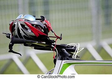 Helmet on the handlebars of a bike in triathlon transition...