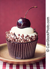 Cherry cupcake - Cupcake decorated with a black cherry and...