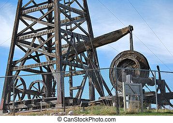 Wooden oil rig. - Vintage wooden drilling oil pump.