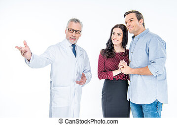 Young couple and doctor