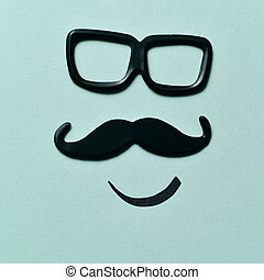 eyeglasses and mustache forming a face - a pair of black...