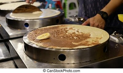 Street vendor cooking delicious pancakes for sale. 4k...