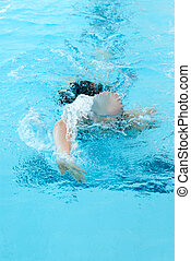 young woman swim on indoor pool. freestyle mode.