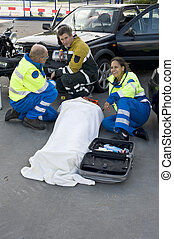 Emergency medical services - fireman and paramedics sitting...