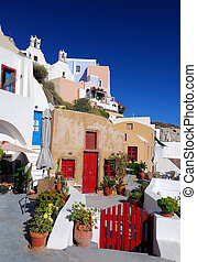 Oia village in island of Thira (Santorini - Cyclades),...