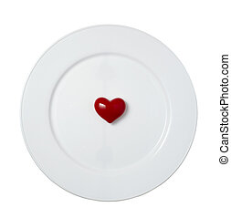 heart shape love romance plate dish - close up of red heart...