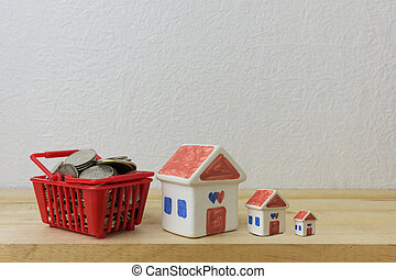 coins in a basket red and House model for money concept