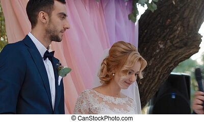 Bride and groom say I do - Young caucasian bride and groom...