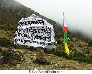 Big mani stone and prayer flags in the Everest National...