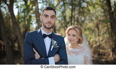 Bride and groom posing outdoor - Young caucasian bride and...