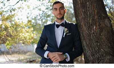 Portrait of the groom.Young man outdoor. - Young man posing...