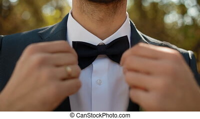 Portrait of young caucasian man outdoor. Groom in blue suit....