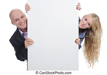 young man with blank sheet - man and woman with large blank....