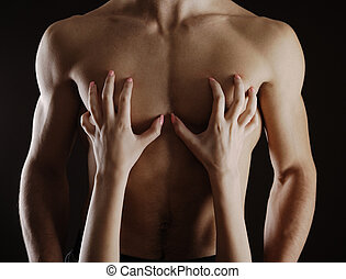 Passion - Close up of woman caressing  her man's chest