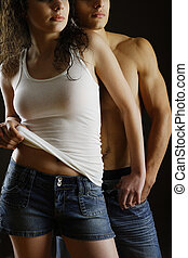 Passion - woman leaning against her man isolated on black