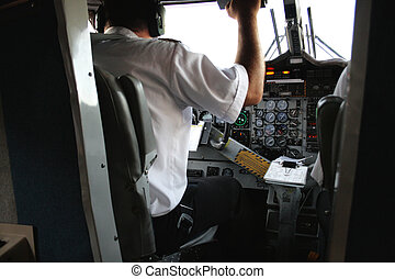 Pilot before taking off, checking the controls of the plane...