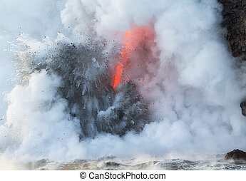 Lava explodes on entry into sea water - Close up of 'fire...