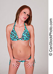 Redhead - Beautiful young redhead in a turquoise bikini