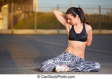 fit woman doing yoga and stretching