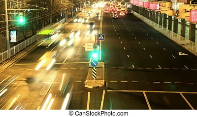 Stream of the cars in the night city. Smooth blurred motion. Timelapse shot