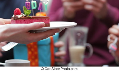 Sharing Birthday Cake - Group of friends are at a small...