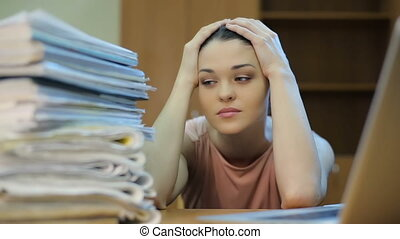 A lot of Paperwork and sad woman - Sad woman at office, with...