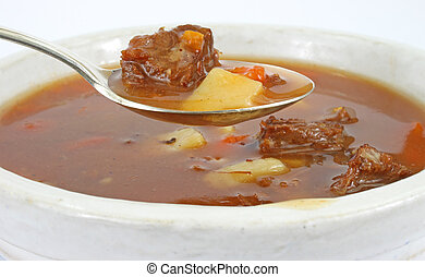 Beef pot roast soup - A serving of beef pot roast soup with...