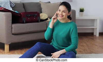 happy woman with travel bag calling on smartphone -...