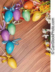 Easter background with colored eggs and flowers