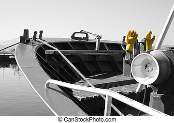 Yellow gloves on the deck of a ship