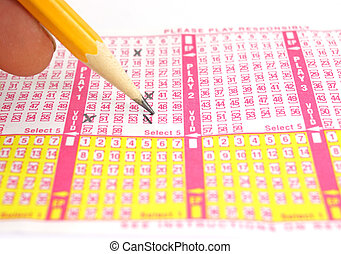 Picking lottery numbers - A close view of selecting lottery...